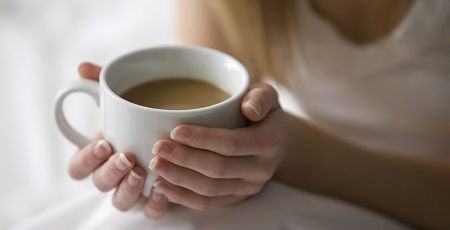 Caucasian woman holding cup of coffee